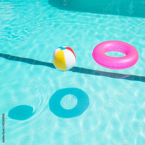 Swimming Pool Beach Ball Background On Bright Pink Float And Beach Balls In Blue Swimming Pool Floating Refreshing Pool With