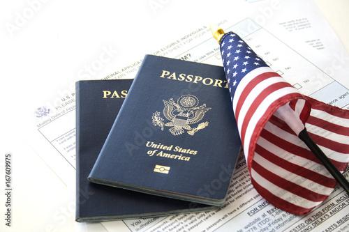 Valokuvatapetti Immigration concept (Passport renewal form, passports and flag)