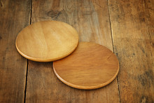 Image Of Wooden Beer Coasters On Textured Table Background