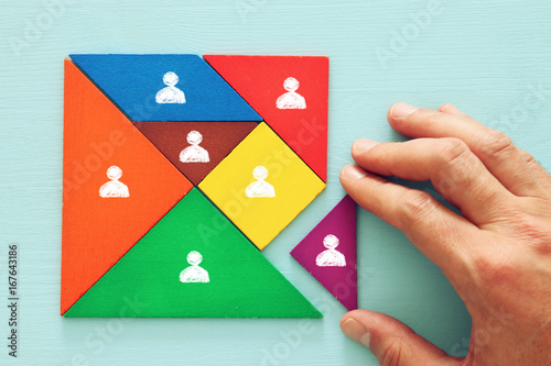 Fotografía  tangram puzzle blocks with people icons ,human resources and management concept
