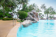 Swimming pool on the territory of tropical hotel in summer day