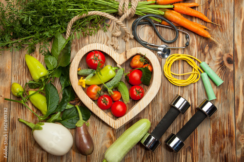 Obraz Sport and diet. Fresh vegetables. Healthy lifestyle. Rustic wooden background. - fototapety do salonu