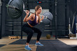 Woman Performing Shoulder Squat with Barbell