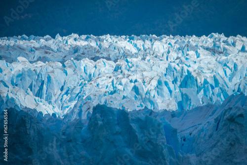 Fotobehang Gletsjers Uneven surface of the glacier in the sun. Shevelev.