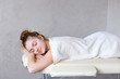 Portrait of beautiful woman who relaxes after massage and looks