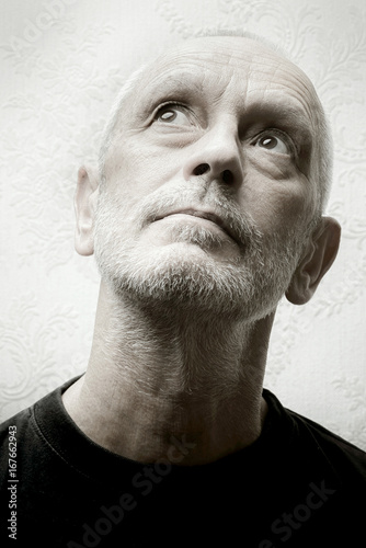 Fotografering  Black and white portrait of an agape and inquisitive caucasian adult man with ey