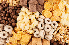 Corn Flakes Set - Rings, Balls, Stars, Pads Chocolate, Golden As Decorative Cereals Background.