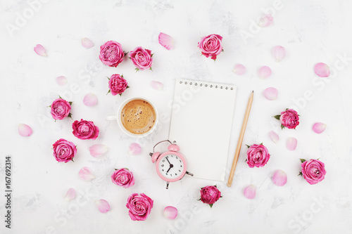 morning coffee cup for breakfast empty notebook petals alarm