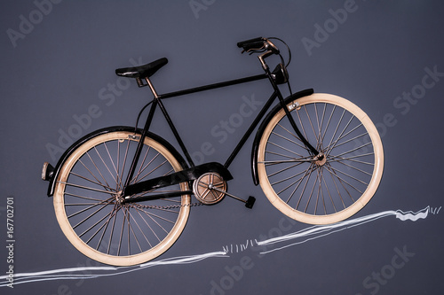 Foto op Canvas Fiets Vintage bicycle on the black wall