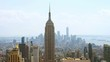 Aerial view on the city skyline in New York City, USA, on a warm sunny summer day with beautiful cloudy sky. A rotating video picturing concrete jungle, including the Empire State Building, Upper Bay.
