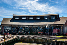 Old Retro Steam Engine Train Locomotives At The Roundhouse