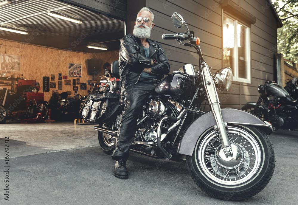 Fototapeta Assured elderly male person ready to ride