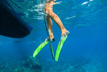 Child In Snorkelling Fins Stand On Divers Boat Ladder For Diving Underwater In Tropical Coral Reef Sea Pool. Travel Lifestyle, Water Sport Outdoor Adventure On Family Summer Beach Holiday With Kids.