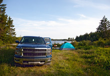 A Pickup Truck On A Campsite