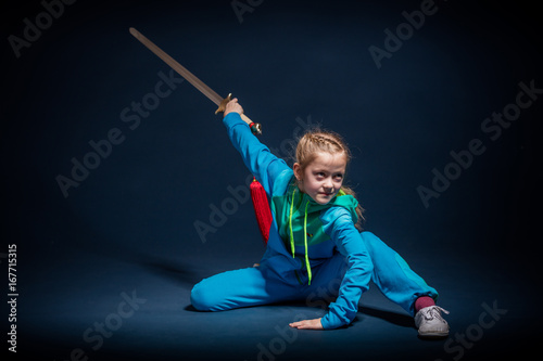 фотографія  Girl in a blue wear engaged wushu