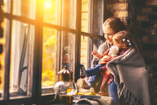 Happy Family Mother And Baby In Autumn Window