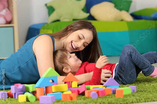 Mother or nanny playing with a child
