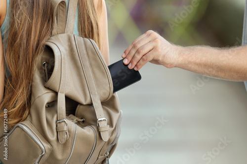 Fotografía  Thief stealing a phone from a bag
