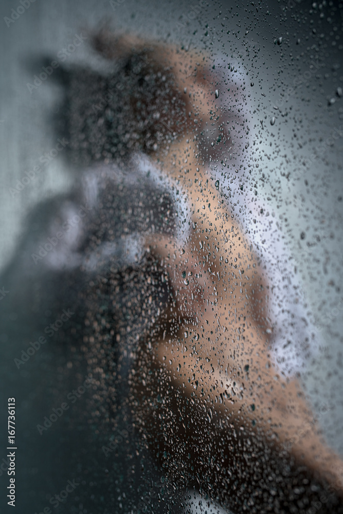 Fototapety, obrazy: Beautiful woman in shower shot behind wet glass