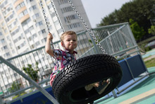 Child On Swing Out Of Tire
