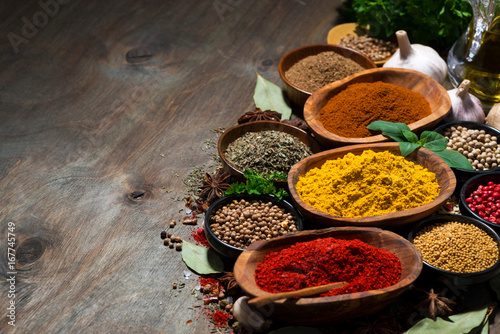 assortment of oriental spices on a wooden background