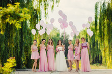 Bride With Bridesmaids In Pink...