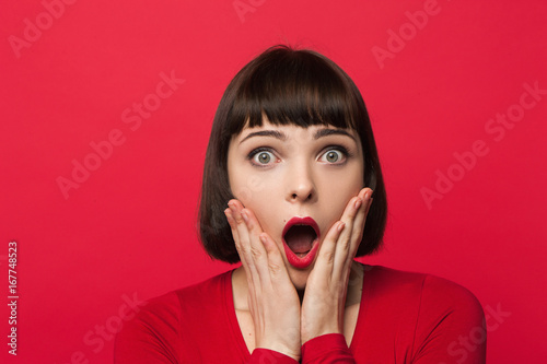 Astonished young female Fototapet