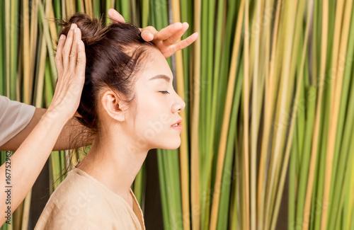Women is having head massage relaxation on tree background Fototapet