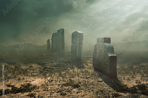 Tombstone and graves in an ancient church graveyard, halloween concept Canvas Print