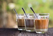 Hot Drink Thai Milk Tea, Black Coffee, Cocoa Signature Local Street Beverage On Wooden Table