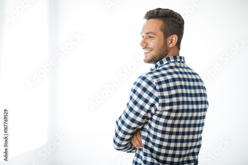 Side view portrait of smiling handsome man on white background