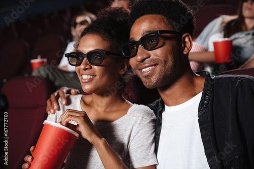 Fotografie, Obraz  Smiling attractive afro american couple watching 3D movie