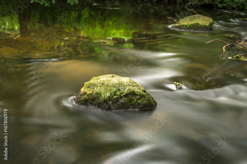 Stone and water in a small brook, time exposure Canvas Print