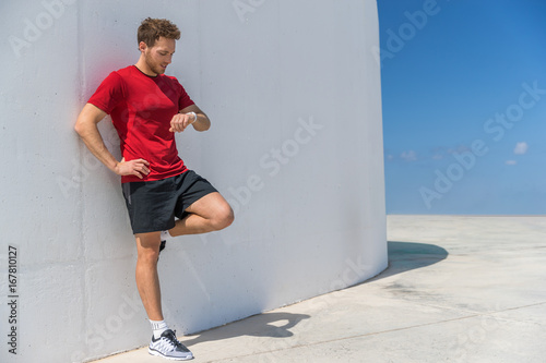 Smartwatch runner man checking progress on smart fitness