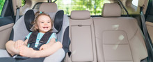 Infant Baby Girl Buckled Into ...