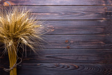 Wheat Stems, On Wooden Background Harvest Concept