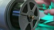 Person places film on spool, close up