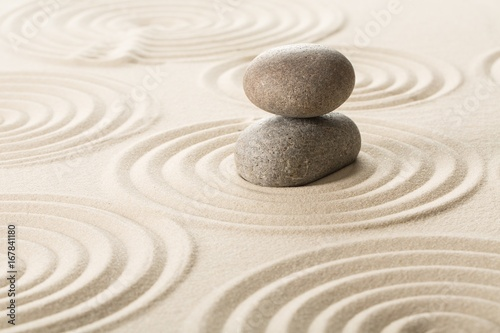 Photo Stands Stones in Sand Stone on sand.
