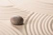 Stone on sand.