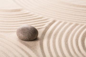 Fototapeta na wymiar Stone on sand.