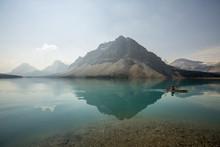 Glacial Lake With Mountains And Kayaker