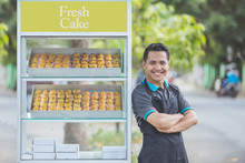 Small Business Owner And His Food Stall