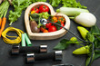 Leinwanddruck Bild - Fresh vegetables. Diet, a healthy lifestyle. Sport, dumbbells and skipping rope on a black background