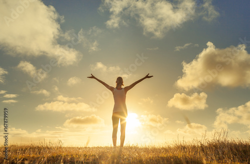 Obraz Happy woman with arms in air feeling free. - fototapety do salonu