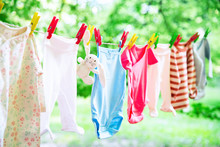 Baby Clothes Hanging On The Cl...