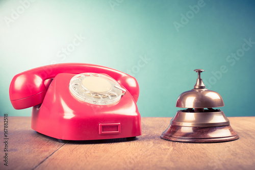 Retro Telephone And Hotel Reception Service Desk Bell Old Style Filtered Photo