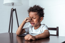 Boy Crying While Sitting With ...