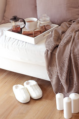 Fototapeta na wymiar Cozy autumn. Home cosiness. Knitted plaid, hot tea, biscuits. Warm winter.