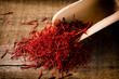 Leinwanddruck Bild - saffron threads with spice shovel on wooden background