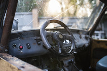 Steering Wheel And Broken Glass Of An Old Car